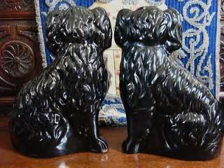 PAIR ANTIQUE STAFFORDSHIRE BLACK JACKFIELD DOGS / SPANIELS
