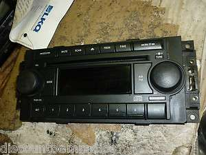 04 07 Chrysler Dodge Jeep Radio Control Face Plate P05091710 REF