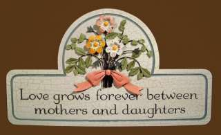 Lovely wood plaque with dimensional metal flower bouquet. The message