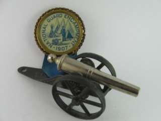 1907 GAR NATIONAL GUARD ENCAMPMENT PINBACK PIN BADGE MEDAL WITH CANNON