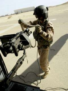 Sergeant Carries 762 mm Rounds to Her M240G Medium Machine Gun Aboard